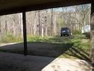 View from kitchen door. Parking area.