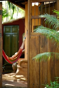 Antique Nicaraguan doors are the entrance to the Villa Suite with private patio.