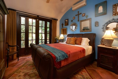 The elegant Villa Suite with art and mirrors from our travels.