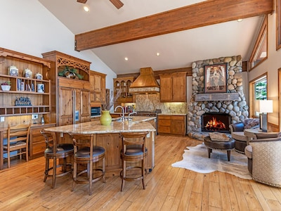 Kitchen with fireplace and views!