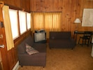 Living Room with knotty pine paneling, 2nd couch.