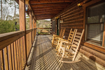 Relaxing front porch with rocking chairs and a swing