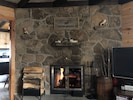 Natural field stone wood burning fireplace in Living Room
