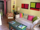 Living area with pull out sofa bed, cable TV/DVD, CD/iPod dock, free WiFi, A/C.