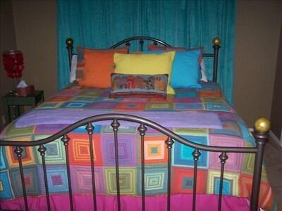 Bedroom #1:   King bed;  flatscreen TV; private bathroom, large closet.