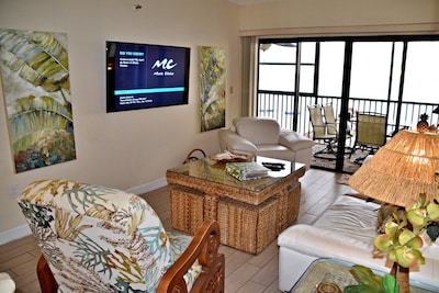4 recliners with beach front views and Smart 55 inch TV
