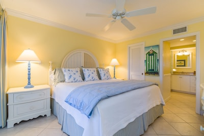 Master Bedroom Has A King Sized Bed,  Adjoining Bathroom And A Samsung TV