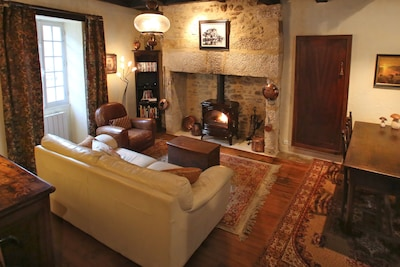 Main living area on ground floor with stone fireplace