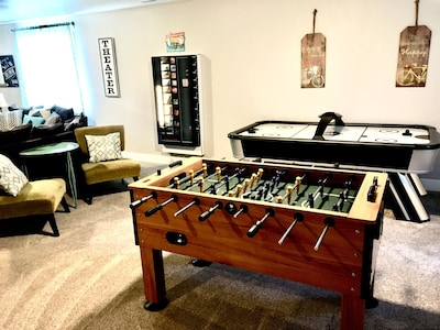 Game room with foosball, air hockey, and a vending machine.