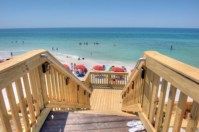Private beach access with Redfish Village red umbrellas. Comes with 2 chairs.