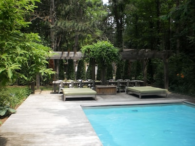 Pool, pergola, and outdoor dining table