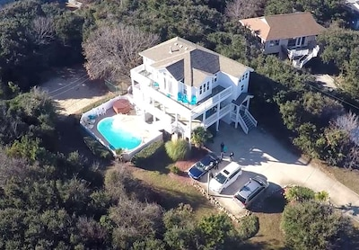 Aerial view of the DolphinInnOBX.  7 Bedroom house.  4 minute walk to beach