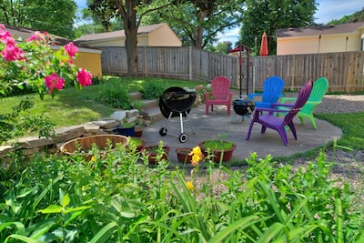 Backyard is well landscaped complete with gas BBQ and fire pit