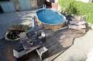Bird's eye view of pool and decking from bedroom