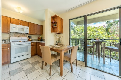 Kitchen and dining area overlooking the topical plants in our private lanai.