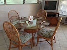 Dining room glass table, 25' TV, DVD, Wifi, and living room air conditioning.