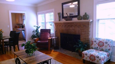 Large open design living area with gas fireplace