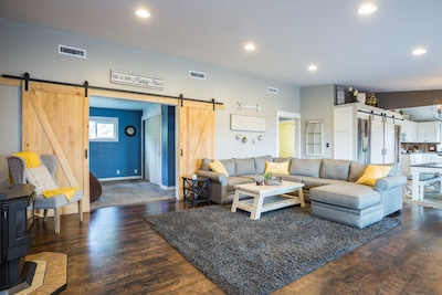 """Plenty of seating with our high end comfy couch and a couple chairs. 70""""tv"""