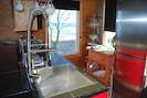 Kitchen with full refrigerator, 4 burner gas cooktop, convection microwave/oven