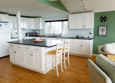 Large, newly renovated chefs kitchen is fully equipped for your convenience.