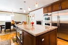 All stainless steel appliances, double ovens, warming drawer, built in microwave