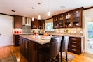 State of the art luxurious gourmet kitchen, fine finishes & appliances, stocked