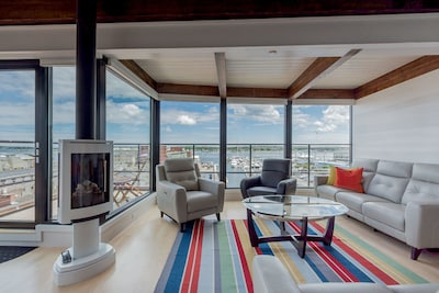 Living area with expansive views of harbor and city.