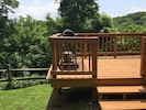 DECK CONNECTED TO FRONT PORCH...PERFECT FOR GRILLING AND PARTYING!!