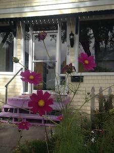 Front door with Cosmos in bloom