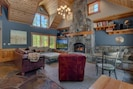Gather amidst leather sofas and recliner, wool rugs, cathedral ceilings.