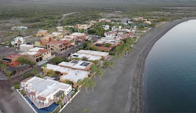 Located on the beach in community of upscale  homes.