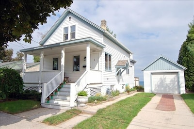 Street view with Front porch and Garage