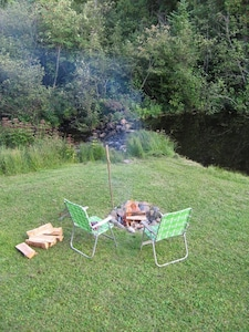 The firepit and our tiny meadow on the river.