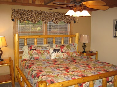"""""""Bear"""" bedroom with King Bed, 4"""" memory foam topper & 32"""" tv on the Main Floor."""