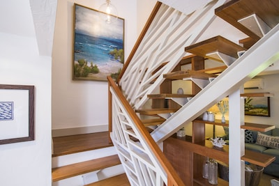 Stairs to upstairs two beds two baths