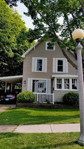 Exterior of our 1910 home complete with original historic lamp post.