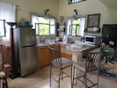 Kitchen with full size refrigerator and 2 NuWave cook tops