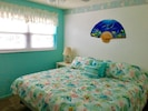 King size bed in our Florida style bedroom.