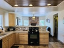 Fully equipped kitchen: refrigerator, stove/oven, dishwasher, microwave.