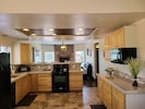 The kitchen & dining room are open to the living room, a great gathering place.