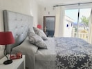 Master suite with views to garden.  Super king size bed