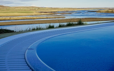 Soak up in the hot tub while enjoying the breathtaking view