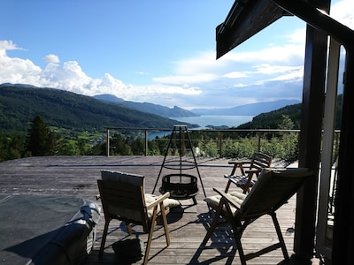 Enjoy peace and tranquility with the  wiew towards the mountains and fjord.