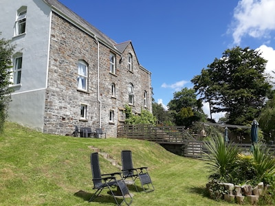 Woodlands is a former 19th century vicarage, overlooking the Aeron Valley
