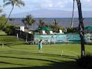 View from lanai of putting green, pool, fishpond, ocean, island of Lanai