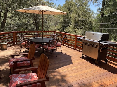 Large deck with BBQ, table & chairs, umbrella, lounge chairs.