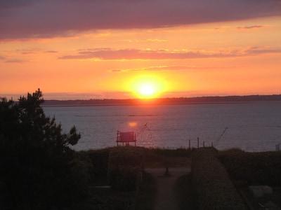 vue sur coucher de soleil depuis la chambre principale