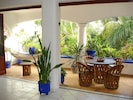 Living Room Opens To Tropical Balcony .