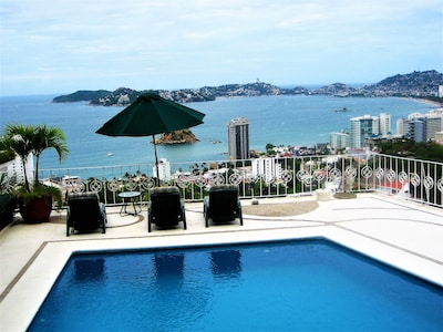 Pool and lounge deck overlooking Acapulco Bay