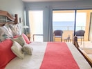 Master bedroom with balcony and sweeping views of the Caribbean
